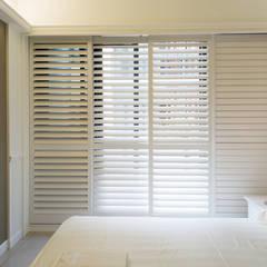 幸福:  臥室 by 松泰室內裝修設計工程有限公司