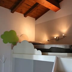classic Nursery/kid's room by Essenza Legno