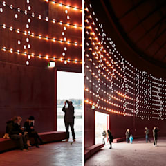 Centros de exhibiciones de estilo  por Ro Lighting Design