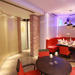 decoração elegante, com luz e cõr: Espaços de restauração  por perez ipar arquitectura  e decoração