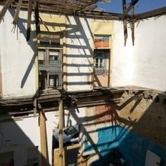 Lofts Cândido dos Reis -  Fachada pré-existente: Paredes  por PROJETARQ