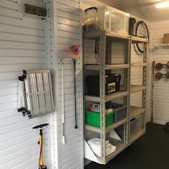 Give your bike pride of place in this tidy and organised garage:  Garage/shed by Garageflex
