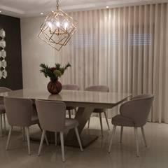 Duplex elegante e sofisticado: Salas de jantar  por Alma Braguesa Furniture ,Moderno MDF