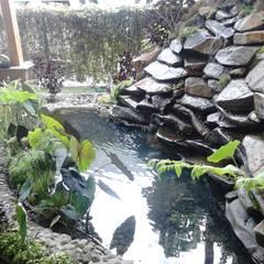 vista lateral: Jardines de estilo  por Ambient Natura