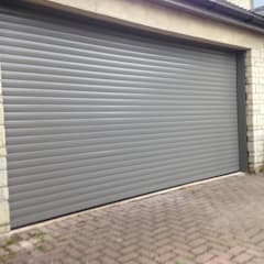 Double garage door:  Garage/shed by Roller Door Pros