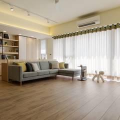 Living room by 詩賦室內設計,