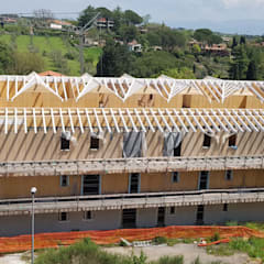Multipiano in Xlam a Sacrofano (RM): Condominio in stile  di Technowood srl