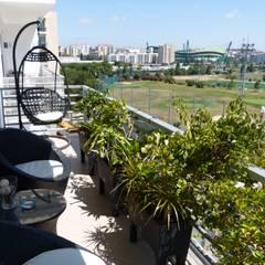 Apartamento T3 Alvalade: Terraços  por EU LISBOA