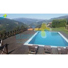 Excelente Moradia em condomínio fechado, com piscina privativa com vista para a Albufeira da Caniçada. Referência: clix mais v1.165 Piscinas campestres por Clix Mais Campestre