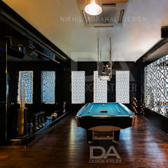 Pool Table Area with client's name cutout in back lit MDF:  Pool by Design Atelier