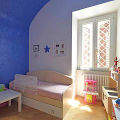 Nursery/kid's room by silvestri architettura,