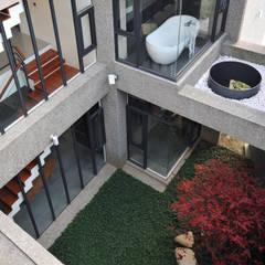 Jardines de estilo  por 黃耀德建築師事務所  Adermark Design Studio
