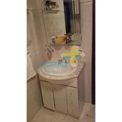 Casa de banho suite (1): Casas de banho  por Clix Mais