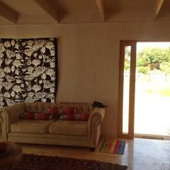 Livings de estilo  por Casas del Girasol