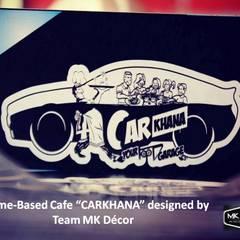 """CarKhana"" ATheme-Based Cafe Designed by Team MK Decor:  Hotels by MK Decor"