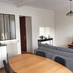 Rénovation appartement Paris 12e: Salle à manger de style de style eclectique par C'Design architectes d'intérieur