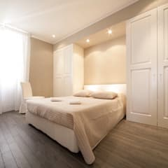 Casa  MT: Camera da letto in stile  di GIAN MARCO CANNAVICCI ARCHITETTO