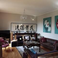 RISTRUTTURAZIONE APPARTAMENTO A MILANO: Soggiorno in stile in stile Asiatico di Studio Architettura Macchi