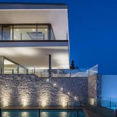 Casas de estilo mediterráneo de GUILLEM CARRERA arquitecte Mediterráneo