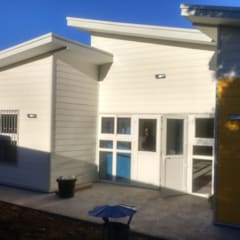 Bungalows de estilo  por Nomade Arquitectura y Construcción spa