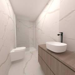Instalação sanitária da Master Suite: Casas de banho  por IAM Interiores