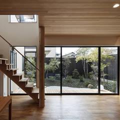 Escaleras de estilo  por 空間工房 用舎行蔵 一級建築士事務所