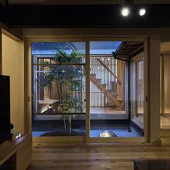 姫路市K邸: 空間工房 用舎行蔵 一級建築士事務所が手掛けた庭です。