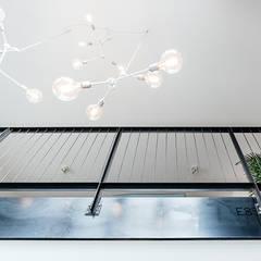 INTERIEUR ONTWERP | ROTTERDAM:  Woonkamer door Studio Kustlijn Architecten
