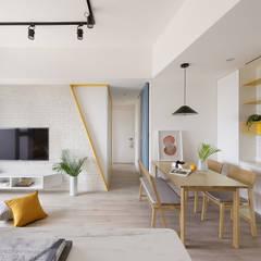 Living room by 寓子設計,