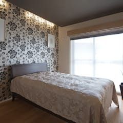 京都市I邸: 空間工房 用舎行蔵 一級建築士事務所が手掛けた寝室です。