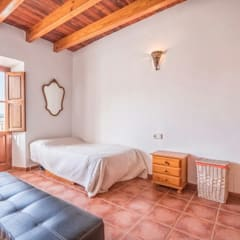 House completely restored in Dalt Vila: classic Bedroom by ibizatophouse
