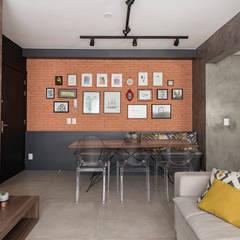 Concreto e Tijolinhos: Salas de jantar industriais por Rabisco Arquitetura