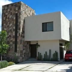 Fachada con torre de piedra: Casas unifamiliares de estilo  por Alberto M. Saavedra