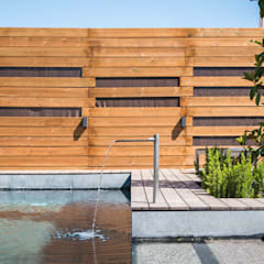 The Green Pool- Piscina Zen en Madrid: Piscinas de estilo  de AGi architects