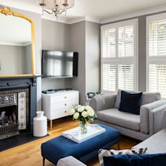 Tier on Tier Shutters in the Living Room: modern Living room by Plantation Shutters Ltd