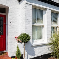 Exterior:  Multi-Family house by Plantation Shutters Ltd