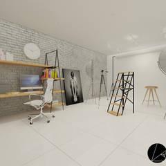 ESTUDIO FOTOGRÁFICO NAVARRO : Oficinas y tiendas de estilo  por T+F Arquitectos