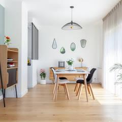 Aménagement et décoration de la piece de vie: Salle à manger de style  par GRAM Architecture
