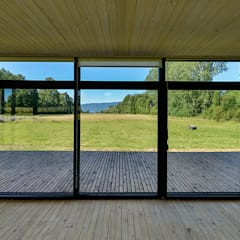 Casa en Molco: Livings de estilo  por mutarestudio Arquitectura