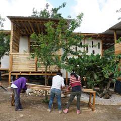 Log cabin by Juan Carlos Loyo Arquitectura, Country
