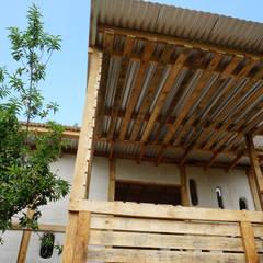 Log cabin by Juan Carlos Loyo Arquitectura,