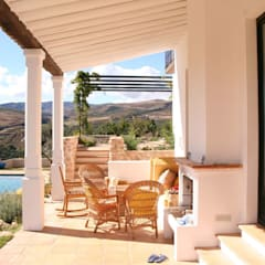 Casa de campo: Terrazas de estilo  de Mirasur Proyectos S.L.