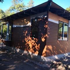 Casa Lavin Gonzalez: Casas de campo de estilo  por ATELIER3
