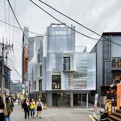 Commercial Spaces by 보편적인 건축사사무소
