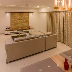 3 bhk complete home interiors in Blue Ridge Township ( Pune) :  Living room by The D'zine Studio