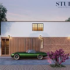 Fachada Lateral: Casas unifamiliares de estilo  por Stuen Arquitectos