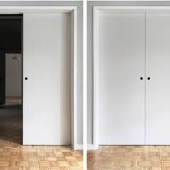 Puertas corredizas de estilo  por PortoHistórica Construções SA