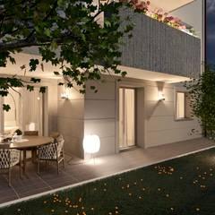 Esterno piano terra con giardino - versione notturna: Giardino anteriore in stile  di Gentile Architetto