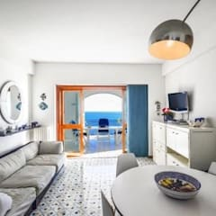 Living room by COSTRUZIONI ROMA SRL, Mediterranean