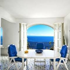 Dining room by COSTRUZIONI ROMA SRL